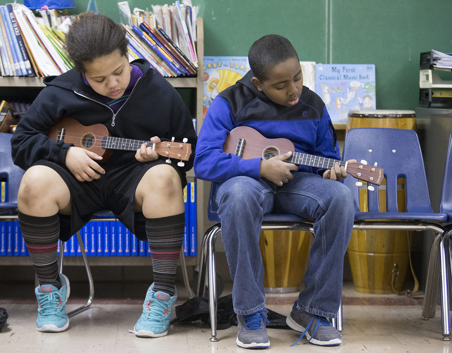 Students play the ukulele